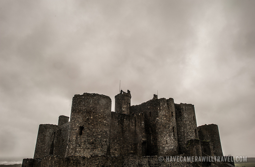 Threatening clouds over Harlech Castle in Harlech, Gwynedd, on the northwest coast of Wales next to the Irish Sea. The castle was built by Edward I in the closing decades of the 13th century as one of several castles designed to consolidate his conquest of Wales.