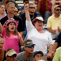 NAPLES, FL -- March 6, 2011 -- Race fans cheer during the Swamp Buggy Races at the Florida Sports Park in Naples, Fla., on Sunday, March 6, 2011.  The races originated in the 1940's by bored hunters and draws thousands of fans three times a year to take in the buggies and jeep compete in the swamp. (Chip Litherland for ESPN the Magazine)