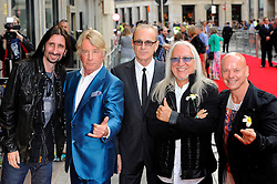 Bula Quo UK film premiere.  <br /> Rick Parfitt, Francis Rossi (second and third from left) and Uriah Heep attend premiere of Status Quo action film featuring 12 of the rock band's classic tracks. Directed by former stunt co-ordinator Stuart St Paul, starring Jon Lovitz, Craig Fairbrass, Laura Aikman and the band members themselves. Released July 5. Odeon West End, London, United Kingdom.<br /> Monday, 1st July 2013<br /> Picture by Chris Joseph / i-Images