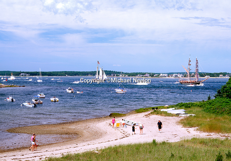 Tall ships passing by Gray Gables Beach, Bourne at the entrance to the Cape Cod Canal.