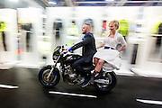 In Utrecht geven Anne van Os (op de foto) en Nomi Brands uit Wijk bij Duurstede elkaar het jawoord als opening van de 30e Motorbeurs in de Jaarbeurs. De twee vrouwen zijn fervente motorrijders en zijn achterop de motor naar de trouwlocatie op de beurs gereden.<br /> In Utrecht Anne van Os and Nomi Brands from Wijk bij Duurstede are married as the opening of the 30th Motorcycle Exhibition in the Jaarbeurs. The two women are avid motorcyclists and drove at the back of a motorcycle to the wedding venue at the fair.
