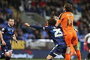 Bolton Wanderers midfielder Lawrie Wilson and Brett Pitman, Ipswich Town forward tussle in the area for space during the Sky Bet Championship match between Bolton Wanderers and Ipswich Town at the Macron Stadium, Bolton, England on 8 March 2016. Photo by Simon Brady.