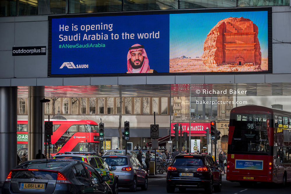 """On the first day of his official 3-day visit to London, the face of Saudi Crown Prince Mohammed bin Salman appears on a large billboard in Holborn, on 7th March 2018, in London England. Industry sources said the Saudis could be spending close to £1m on the city-wide campaign, which includes dozens of prime poster sites around London and newspaper ads. """"He is bringing change to Saudi Arabia,"""" the ads say, with a large photo of Crown Prince Mohammed bin Salman and the hashtag #ANewSaudiArabia."""