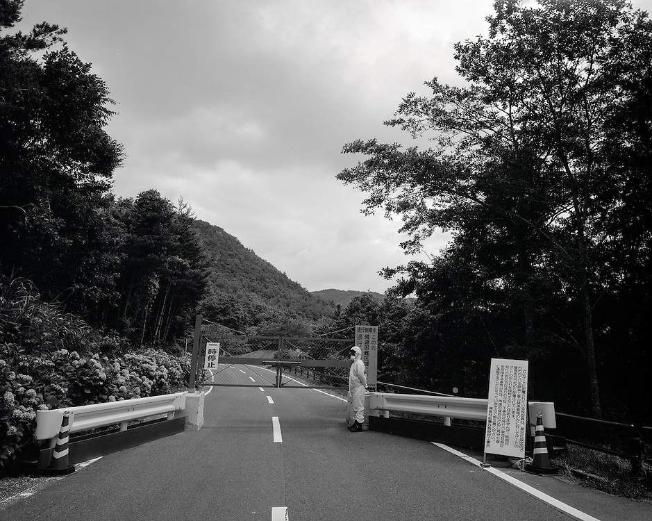 Entrance to Nagadoro, Iitate village  Fukushima , The  Japanese Government after  18 months of inaction   finally declares Nagadoro district of IItate Village a closed  contaminated zone  prohibiting access to the  area by the  general public. some of the  highest levels of radioactive contamination have been found here. a hotspot found outside these gates registered over 250 microsieverts of radiation well about limits deemed harmful to humans.