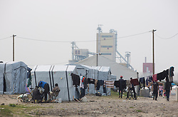 © Licensed to London News Pictures. 30/08/2015. Calais, France. The refugee camp in Calais, also known as the Jungle. Tomorrow the French PM, Manuel Valls, will visit the day centre Jules Ferry at the camp. Photo credit : Isabel Infantes/LNP