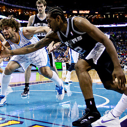 Jan 7, 2013; New Orleans, LA, USA; New Orleans Hornets center Robin Lopez (15) and San Antonio Spurs small forward Kawhi Leonard (2) battle for a loose ball during the first quarter of a game at the New Orleans Arena. Mandatory Credit: Derick E. Hingle-USA TODAY Sports