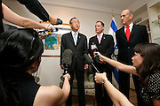 Secretary-General Ban Ki-moon (left) speaks to the press following a meeting with Ehud Olmert (right), Prime Minister of Israel, at the residence of Dan Gillerman (centre), Permanent Representative of Israel to the United Nations in New York.