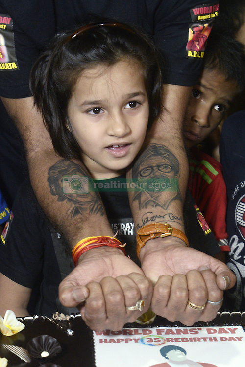 August 2, 2017 - Kolkata, West Bengal, India - Amitabh Bachchan fan show tattoo if Amitabh Bachchan in his arm during World Fans day celebration in Kolkata. Members of All Bengal Amitabh Bachchan Fans Association celebrated World Fans Day on August 2, 2017 in Kolkata. On this day Actor Amitabh Bachchan came out of coma after he met an accident during a Hindi film shoot in 1982. (Credit Image: © Saikat Paul/Pacific Press via ZUMA Wire)