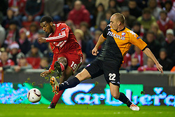 LIVERPOOL, ENGLAND - Wednesday, December 15, 2010: Liverpool's Ryan Babel and FC Utrecht's Sander Keller during the UEFA Europa League Group K match at Anfield. (Photo by: David Rawcliffe/Propaganda)
