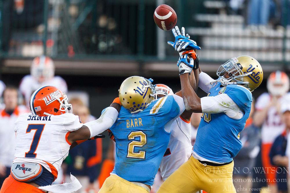 Dec 31, 2011; San Francisco CA, USA;  UCLA Bruins quarterback Nick Crissman (right) and running back Anthony Barr (2) are unable to catch a pass against the Illinois Fighting Illini during the third quarter at AT&T Park.  Mandatory Credit: Jason O. Watson-US PRESSWIRE