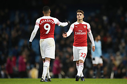 Arsenal's Alexandre Lacazette and Denis Suarez react after the final whistle during the Premier League match at the Etihad Stadium, Manchester.