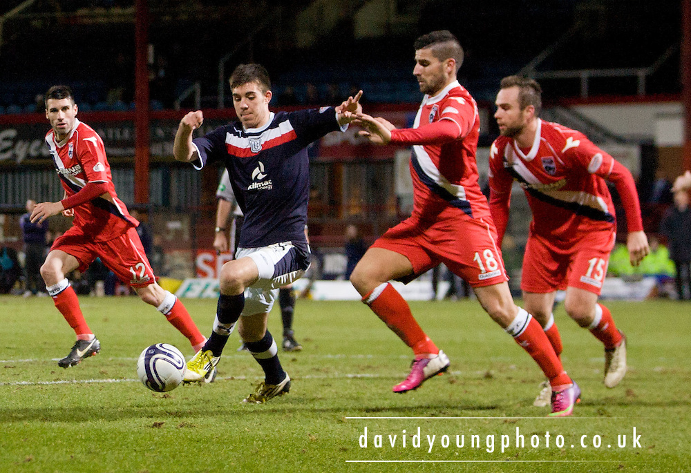 Vaggelis Oikonomou  tries to shut down Declan Gallagher  - Dundee v Ross County, Clydesdale Bank Scottish Premier League at Dens Park .. - © David Young - www.davidyoungphoto.co.uk - email: davidyoungphoto@gmail.com