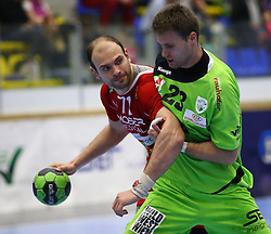 12.04.2014, BSFZ Suedstadt, Maria Enzersdorf, AUT, HLA, SG INSIGNIS Handball WESTWIEN vs Moser Medikal UHK Krems, im Bild Vlatko Mitkov, (Moser Medikal UHK Krems, #71) und Milan Ivanovic, (SG INSIGNIS Handball WESTWIEN, #23) , EXPA Pictures © 2014, PhotoCredit: EXPA/ T. Haumer