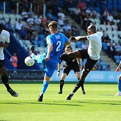 TELFORD COPYRIGHT MIKE SHERIDAN Andre Brown of Telford scrambles to get out of the way as Theo Streete of Telford volleys towards goal during the National League North fixture between AFC Telford United and Leamington AFC at the New Bucks Head on Monday, August 26, 2019<br /> <br /> Picture credit: Mike Sheridan<br /> <br /> MS201920-005