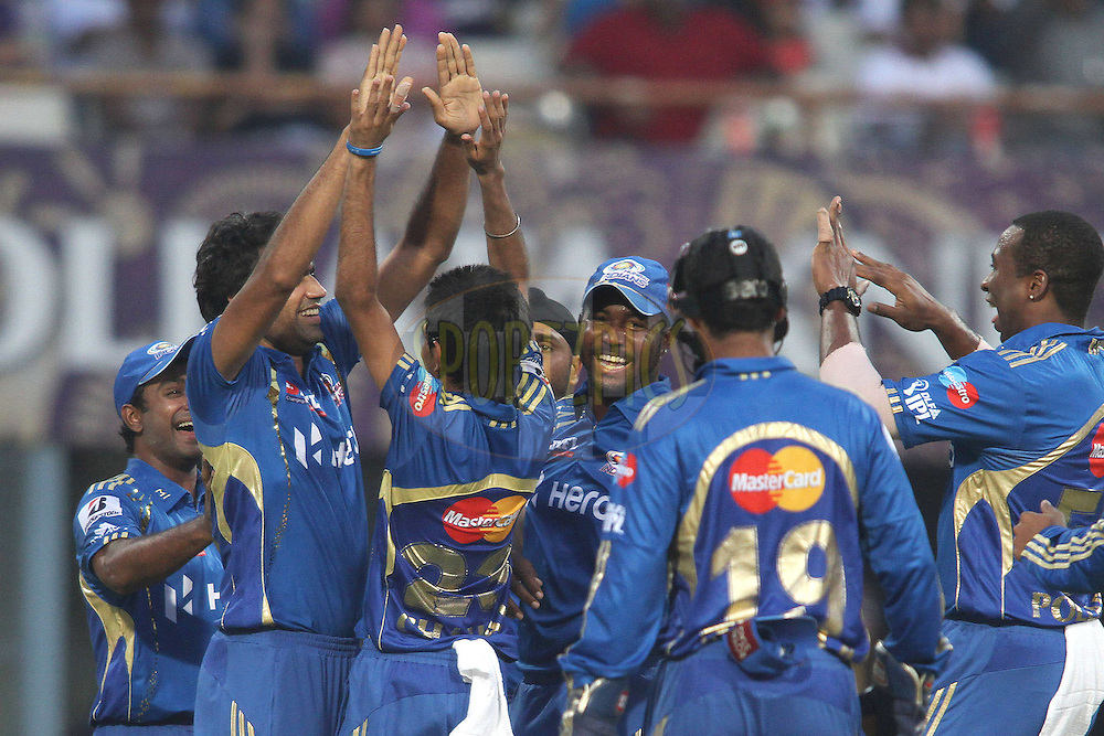 Mumbai Indians celebrate Kolkata Knight Riders captain Gautam Gambhir wicket during match 58 of the the Indian Premier League (IPL) 2012  between The Kolkata Knight Riders and The Mumbai Indians held at the Eden Gardens Stadium in Kolkata on the 12th May 2012..Photo by Shaun Roy/IPL/SPORTZPICS