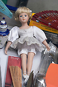 female doll displayed at a flee market