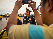02 DECEMBER 2014 - BANGKOK, THAILAND: A Thai police officer watches the crowd at the end of the Trooping of the Colors parade on Sanam Luang in Bangkok. The Thai Royal Guards parade, also known as Trooping of the Colors, occurs every December 2 in celebration of the birthday of Bhumibol Adulyadej, the King of Thailand. The Royal Guards of the Royal Thai Armed Forces perform a military parade and pledge loyalty to the monarch. Historically, the venue has been the Royal Plaza in front of the Dusit Palace and the Ananta Samakhom Throne Hall. This year it was held on Sanam Luang in front of the Grand Palace.    PHOTO BY JACK KURTZ