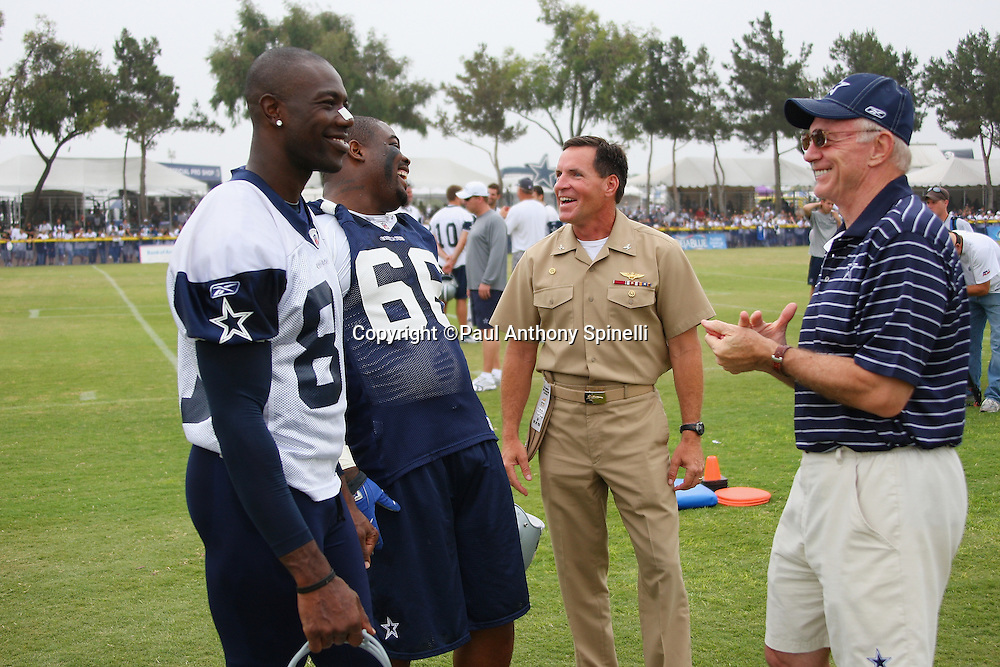 "OXNARD, CA - AUGUST 01:  Team Owner, President and General Manager Jerry Jones (right) of the Dallas Cowboys, wide receiver Terrell Owens #81 (left) of the Dallas Cowboys, and nose tackle Tank Johnson #66 of the Cowboys talk to Captain Brad ""Brick"" Conners, the Commanding Officer of the Naval Base Ventura County, during a break in the action at the 2008 Dallas Cowboys Training Camp at River Ridge Field in Oxnard, California on August 1, 2008. ©Paul Anthony Spinelli *** Local Caption *** Jerry Jones;Terrell Owens;Brad Conners;Tank Johnson"