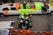 A volunteer casualty is rescued by medics and firefighters during a London Fire Brigade's 'extrication' team's demonstration with the Vehicle and Operator Services Agency (VOSA) on how firefighters rescue passengers by cutting open with dedicated cutting equipment a stretch limousine in London's Covent Garden Piazza. Highlighting the dangers of hiring illegal luxury or novelty cars, this vehicle was seized last year with many mechanical defects rendering it unsafe for those inside with limited exit doors. Of 358 cars stopped in March 2012, 27 were seized and 232 given prohibitions. This scenario is a simulation and therefore reproduces the reality of an emergency, using real emergency services personnel and equipment. Casualties are volunteers and none were injured in the making of this photograph.