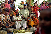 Near Lucknow in North India snake charmers can be seen playing to a crowd of onlookers. Snakes are deaf and therefore cannot hear the bean (flute) being played, rather they move to the movement of the bean as the charmers sways from side to side..ONLY FOR USA AND FRANCE