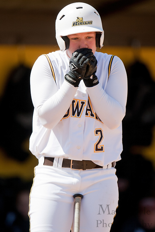 Rowan University junior Nicolina Veneziano (2) warms her hands before batting during the first game of a double header vs Swarthmore College.