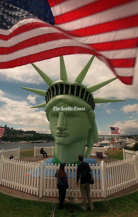 Spectators get a close-up view of the inflatable Statue of Liberty at Gas Works Park.<br /> Ron Wurzer / The Seattle Times