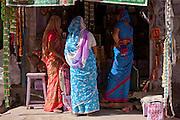 Indian women shopping, street scene Tambaku Bazar in Jodhpur Old Town, Rajasthan, Northern India