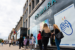 Edinburgh, Scotland, UK. 2 July, 2020. Good weather brought many shoppers out onto Princes Street in Edinburgh. Still busy with people queuing around the block was Primark.  Iain Masterton/Alamy Live News