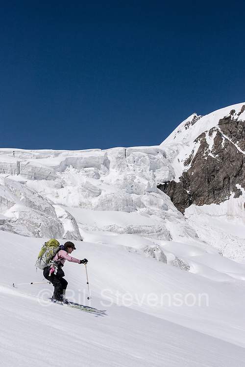 A woman ski mountaineer skiing on the Biafo glacier in the Karakoram Himalaya in Pakistan