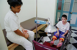 Child with cerebral palsy receiving infrared treatment at a centre for rehabilitation and education in Havana; Cuba,