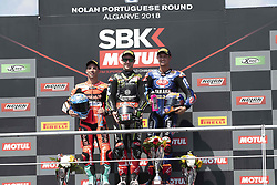 September 15, 2018 - Algarve, Portugal, Portugal - 1 Jonathan Rea Kawasaki ZX-10RR Kawasaki Racing Team,- 33 Marco Melandri Ducati Panigale R Aruba.it Racing-Ducati - 60 Michael van der Mark Yamaha YZF R1 Pata Yamaha Official WorldSBK Team   celebrate on the podium at the end of the race 1 during the World Superbikes race at Autodromo Internacional do Algarve, 14-16 September 2018 in Algarve, Portugal. (Credit Image: © Fabio Averna/NurPhoto/ZUMA Press)
