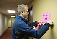 Nick Rhoades puts up signs for a PITCH meeting in Waterloo, Iowa on Thursday, November 7, 2013. PITCH, which stands for Positive Iowans Taking Charge, is a group of HIV+ people who meet together.
