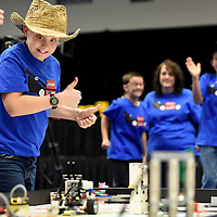 Garrett Boltjes (left), 11, with the Legendary Lego Lawnmowers team gives his teammates and coaches a thumbs up while competing in the robot run during the First Lego League state tournament at the Elmen Center on Saturday. First Lego League (FLL) is a robotics<br /> program for nine to 14-year-olds designed to get kids excited about science, math and technology and is offered through EmBe's youth recreation programs. For more information go to embe.org.