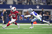 ARLINGTON, TX - AUGUST 26:  Chase Edmonds #29 of the Arizona Cardinals runs the ball and avoids the tackle of Marqueston Huff #20 of the Dallas Cowboys at AT&T Stadium during week 3 of the preseason on August 26, 2018 in Arlington, Texas.  The Cardinals defeated the Cowboys 27-3.  (Photo by Wesley Hitt/Getty Images) *** Local Caption *** Chase Edmonds; Marqueston Huff