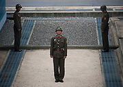THE BOTH SIDES OF THE DMZ<br /> <br /> I first visited the Demilitarized Zone on the North Korean side in 2008. The DMZ is a 250 km long, 4km wide stretch of land that serves as a buffer zone between North and South Korea.<br /> I came back 5 times there before being banned by the North Korean regim.<br /> I visited the DMZ on the South Korean side twice in 2016 and 2017.<br /> The both sides have huge differences but not in the way you may expect sometimes...<br /> The two Koreas have signed armistice but not peace. The Joint Security Area in Panmunjom is called a &laquo; demilitarized zone &raquo;, but in fact it is the most armed zone in the world and also a major touristic attraction both in North and South with more than 100 000 tourists coming there every year.<br /> <br /> Photo shows:  I asked a North Korean colonel on the DMZ:<br /> -What happens if a South Korean crosses the border at the DMZ and comes to the North?<br /> -We welcome him.<br /> -And if a North Korean goes to the South? -They shoot him.<br /> Very few north korean soldiers escape the south in the DMZ, the last one was in september 2016.<br /> &copy;Eric Lafforgue/Exclusivepix Media