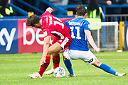 Macclesfield Town midfielder Theo Archibald tackled by  Morecambe defender Tom Brewitt during the EFL Sky Bet League 2 match between Macclesfield Town and Morecambe at Moss Rose, Macclesfield, United Kingdom on 20 August 2019.