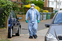 © Licensed to London News Pictures. 28/05/2019. London, UK. A forensic officer on Dyson Road, Forest Gate, East London where a man in his 30s died in the early hours of this morning following a flight on Warwick Road.<br />