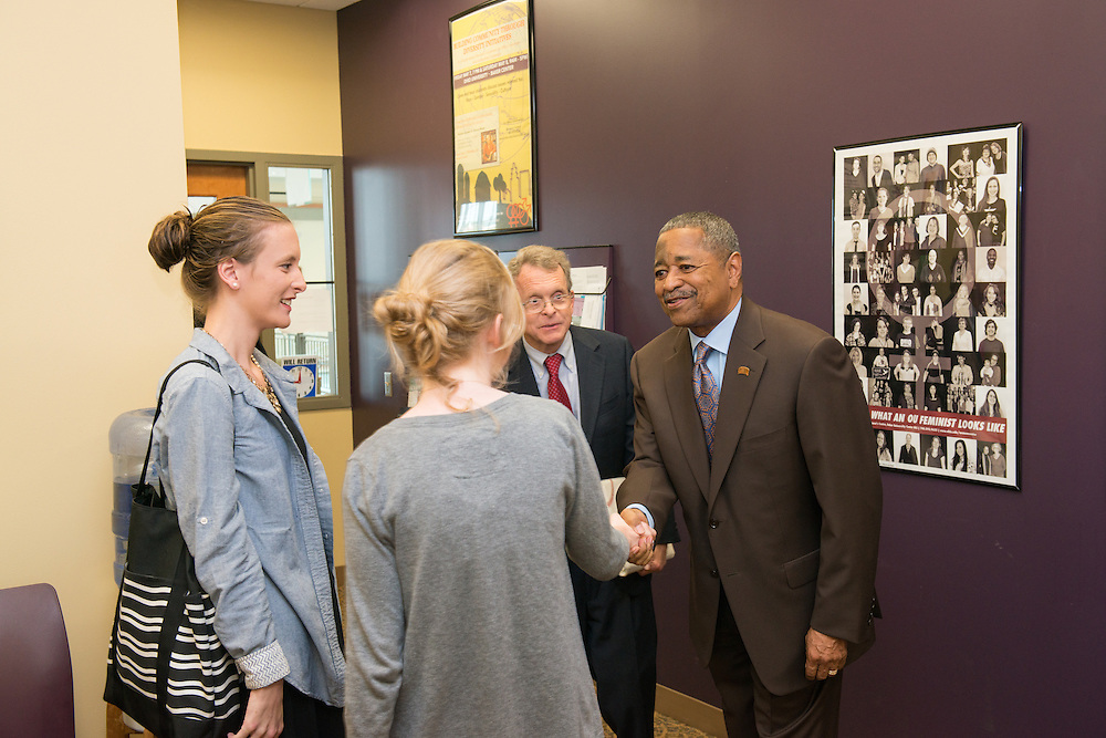 Ohio University President Roderick McDavis (Right) greets Ohio Attorney General Mike DeWine and members of his family at Ohio University's Women's Center. Photo by Ben Siegel/ Ohio University