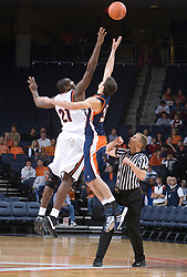 Virginia Cavaliers C Tunji Soroye (21) leaps for the opening tip against Carson-Newman.  The Virginia Cavaliers men's basketball team defeated the Carson-Newman Eagles 124-65 in an exhibition basketball game at the John Paul Jones Arena in Charlottesville, VA on November 4, 2007.