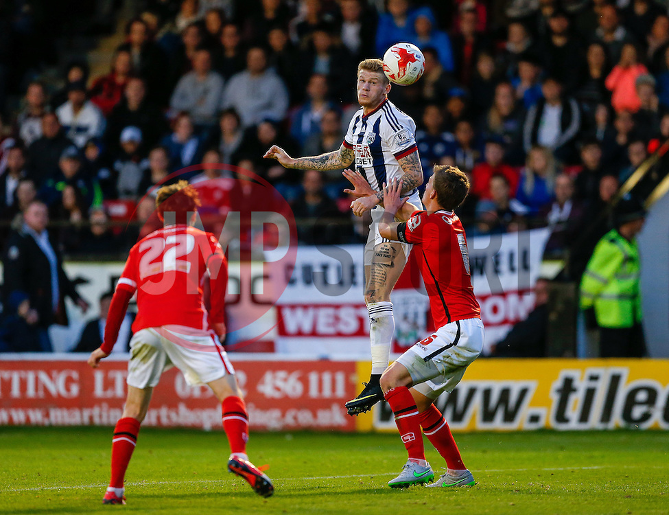James McClean of West Brom and Paul Downing of Walsall compete in the air - Mandatory byline: Rogan Thomson/JMP - 07966 386802 - 28/07/2015 - SPORT - Football - Walsall, England - Besot Stadium - Walsall v West Bromwich Albion - 2015/16 Pre Season Friendly.