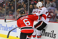 Dec 18, 2013; Newark, NJ, USA;  New Jersey Devils defenseman Andy Greene (6) hits Ottawa Senators right wing Chris Neil (25) during the first period at the Prudential Center.