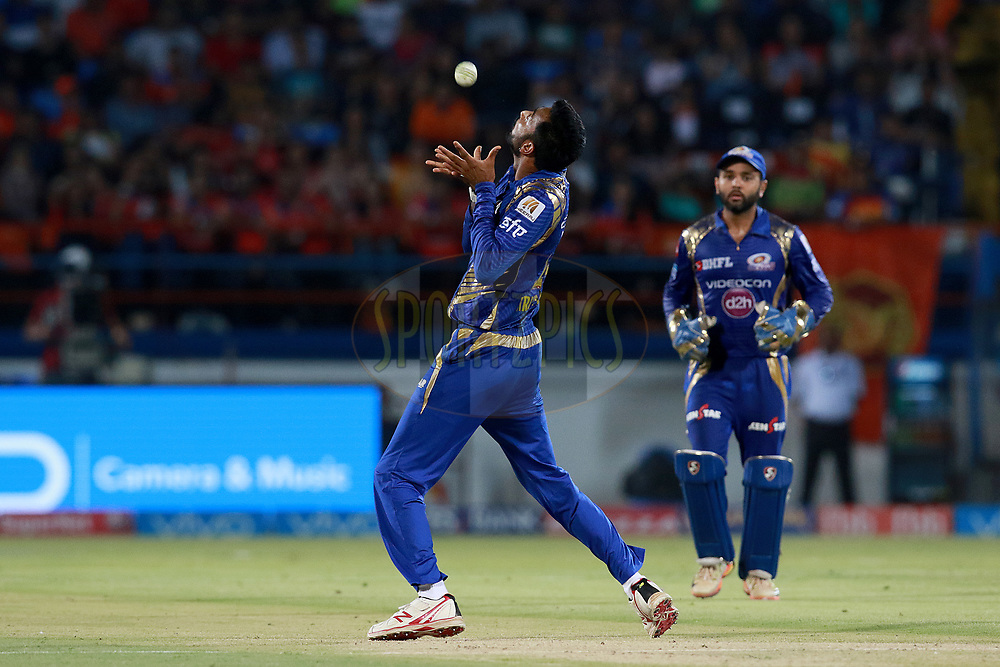 Krunal Pandya of MI takes a catch of Ravindra Jadeja of GL during match 35 of the Vivo 2017 Indian Premier League between the Gujarat Lions and the Mumbai Indians  held at the Saurashtra Cricket Association Stadium in Rajkot, India on the 29th April 2017<br /> <br /> Photo by Rahul Gulati - Sportzpics - IPL