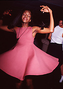Woman Dancing in Pink Dress , London, 1990s.