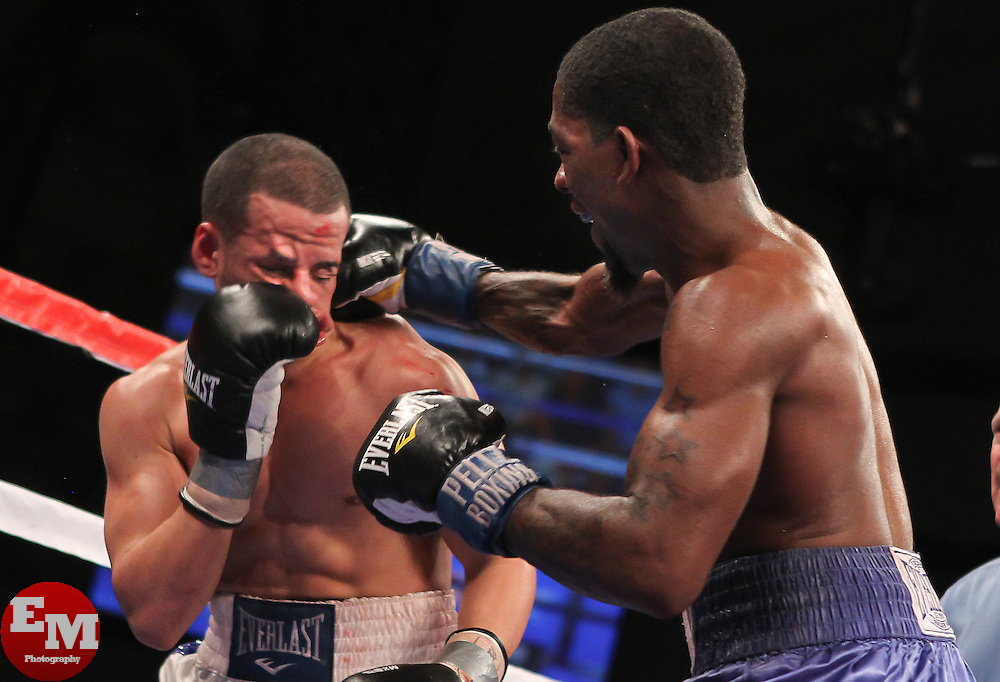 March 26, 2011; Atlantic City, NJ, USA; Jorge Diaz (White/Bruce Trunks) and Teon Kennedy (Blue/White Trunks) during their 12 round USBA Super Bantamweight Championship bout at the Adrian Phillips Ballroom.