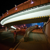 BEIJING, AUGUST 5 :an almost deserted 4th ringroad is seen near the National Stadium during  dress rehearsals for the Olympics .