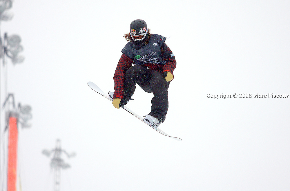 12/20/08 3:23:13 PM -- Breckenridge, CO, U.S.A. -- Snowboarder Shaun White of Carlsbad, Ca. goes airborne high above the superpipe at the inaugural Winter Dew Tour in Breckenridge, Co. on December 20, 2008. White, who has been dominating just about any contest he enters, finished second in the event with a score of 93. The four-day competition is the first of three stops on the tour that features freeskiing and snowboarding..(Photo by Marc Piscotty / © 2008)