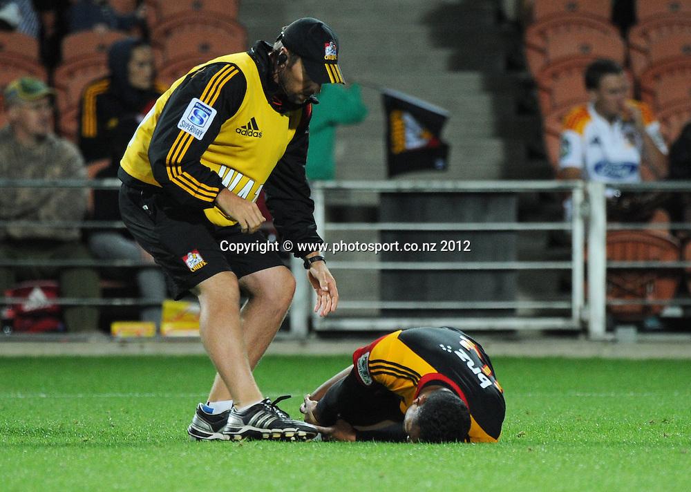 An injured Lelia Masaga during the 2012 Super Rugby season, Chiefs v Highlanders match at Waikato Stadium, New Zealand. Saturday 25 February 2012. Photo: Andrew Cornaga/Photosport.co.nz