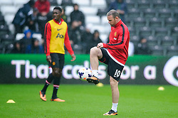 Man Utd Forward Wayne Rooney (ENG) warms up before the match - Photo mandatory by-line: Rogan Thomson/JMP - Tel: Mobile: 07966 386802 17/08/2013 - SPORT - FOOTBALL - Liberty Stadium, Swansea -  Swansea City V Manchester United - Barclays Premier League - First round of the 2013/14 season and the first league match for new Man Utd manager David Moyes.