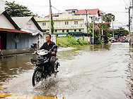 motorbike in chiang mai floods thailand