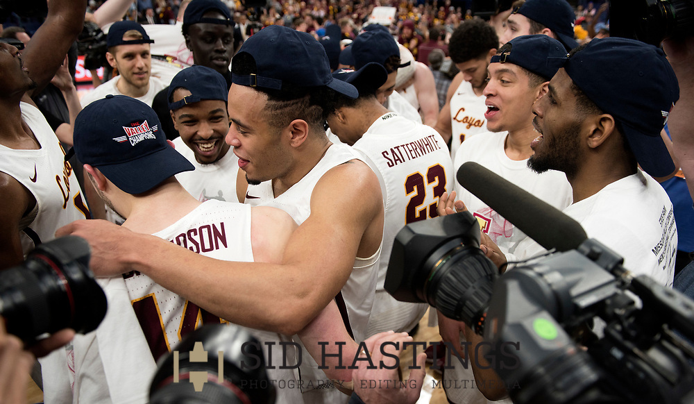 Loyola University Chicago players celebrate after beating Illinois State University during the championship game of the Missouri Valley Conference men's basketball tournament at Scottrade Center in St. Louis Sunday, March 4, 2018. Photo © copyright 2018 Sid Hastings.